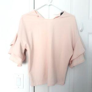 Francesca's pale pink ruffle blouse